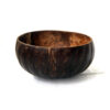 Handcrafted all-natural coconut bowl with pumpkin carvings